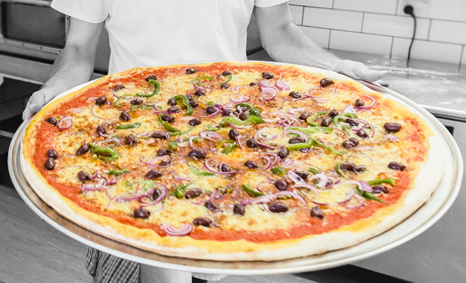 Holding-pizza-veg2